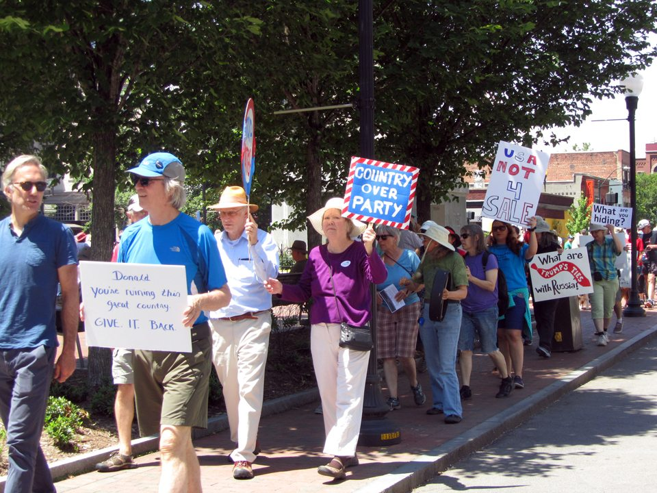 Photo of marchers with signs urging truth and transparency at Asheville NC March for Truth, June 3, 2017