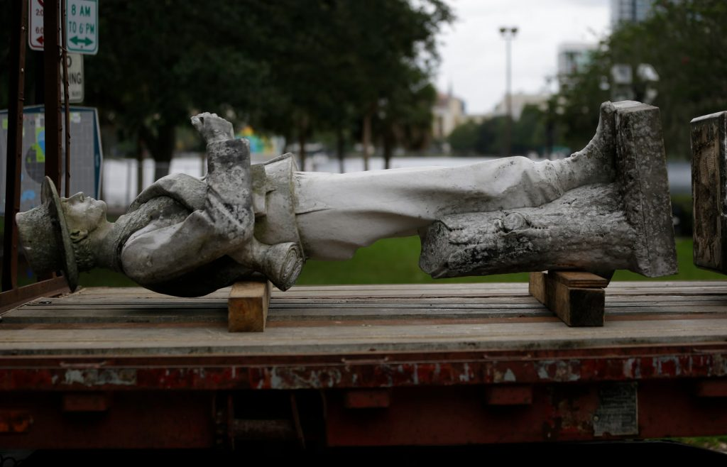 Photo of top section of a Confederate statue called 'Johnny Reb' lying on a lorry in June before being removed from a city park in Orlando, FL