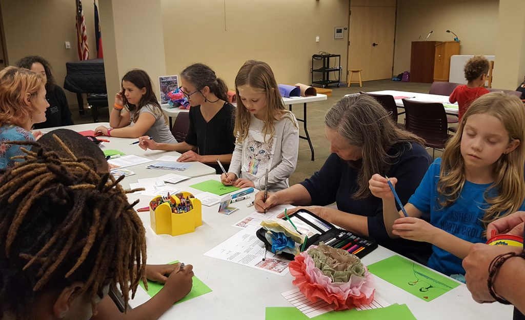 Children and adults gathered Saturday August 24, 2019, in Asheville for card-writing, crafts, and games, protesting the mistreatment of immigrant children and families at the border