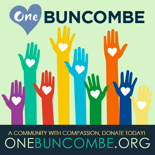 Graphic illustration of raised hands with hearts and the text One Buncombe, a community with compassion, and the URL One Buncombe dot com